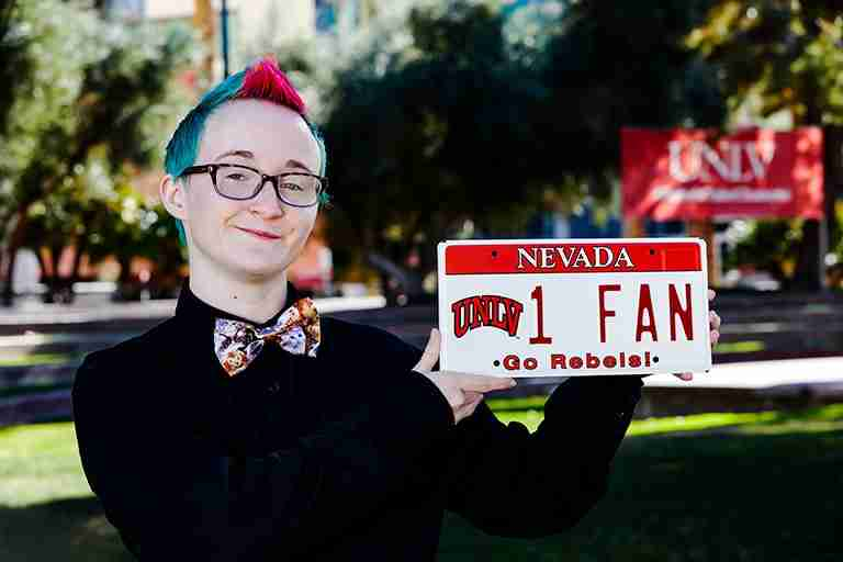 Person holds up license plate
